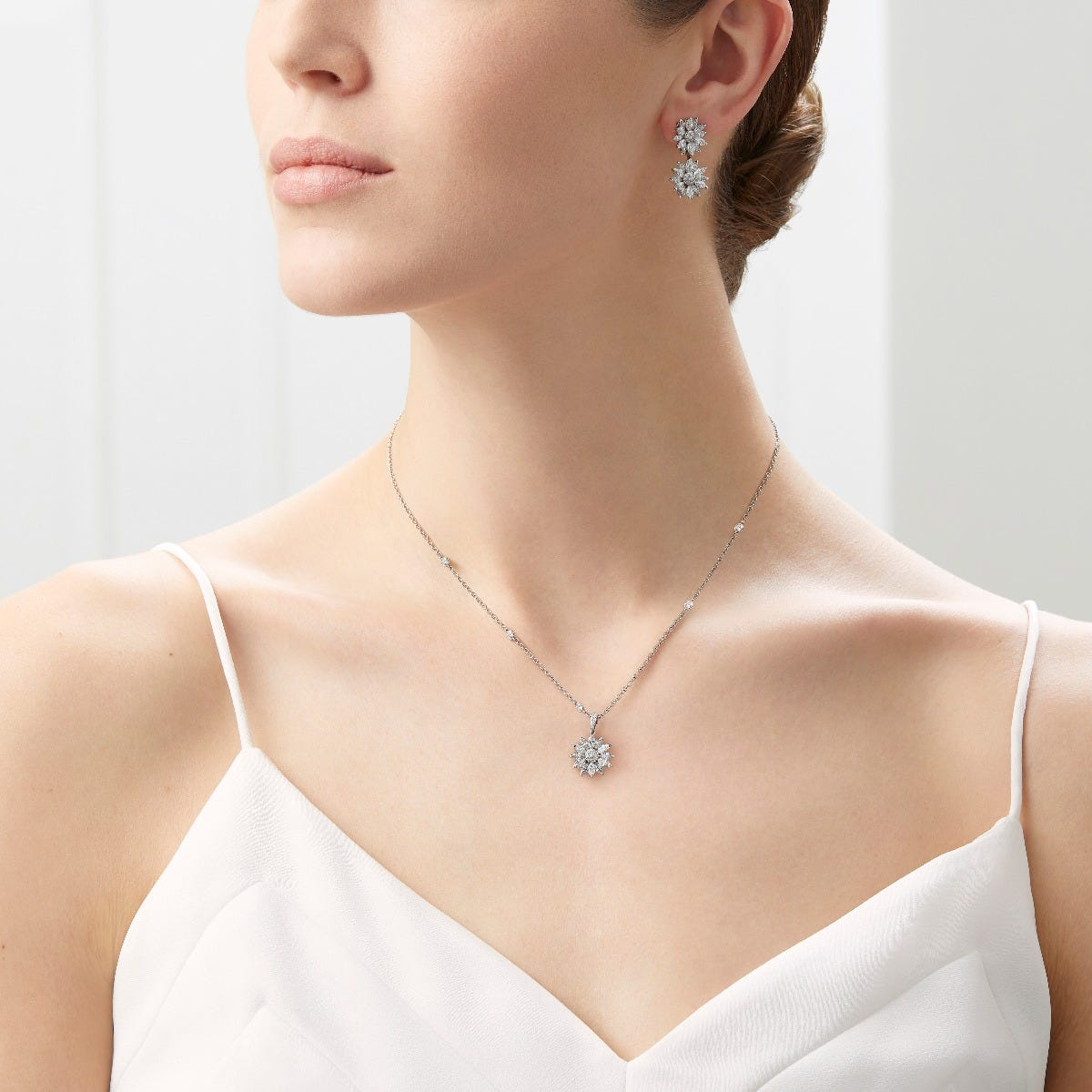 The Duchess of Cambridge wore Asprey London Daisy Diamond Pendant Necklace in 10th Wedding Portraits