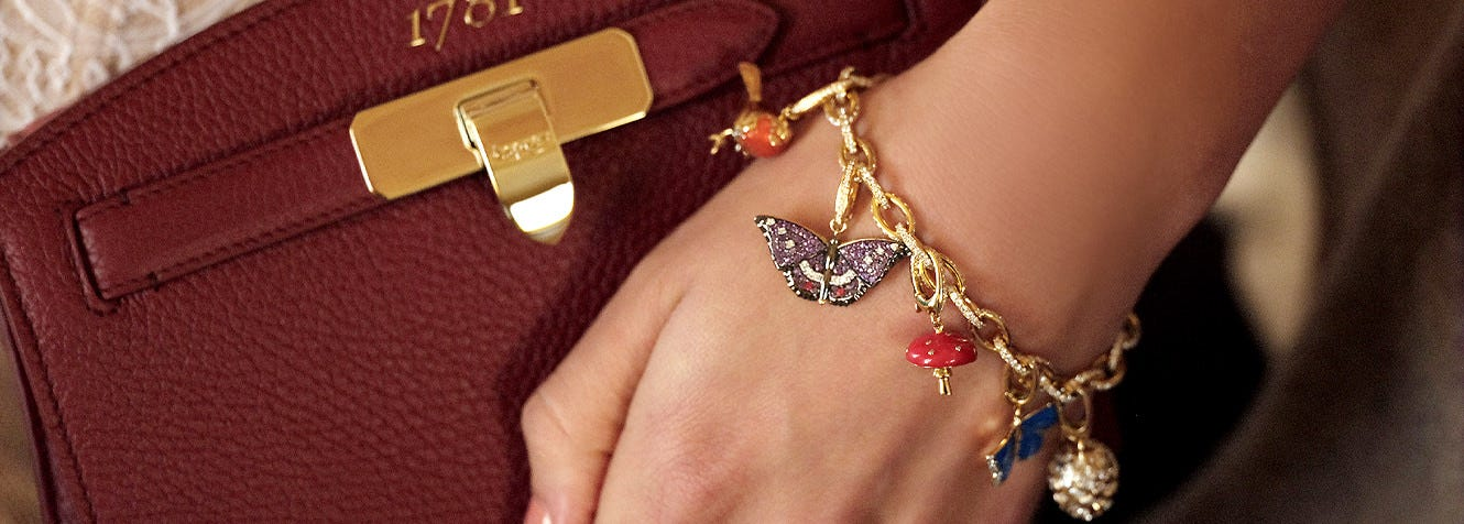 Asprey Woodland charms being worn on a bracelet